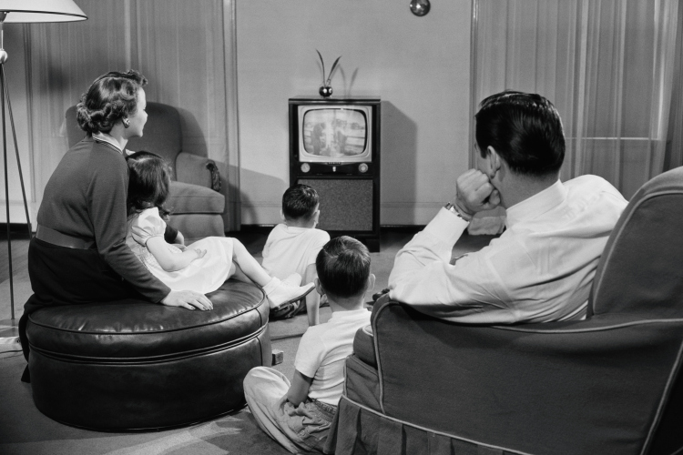 family_watching_tv_in_livingroom_50s.jpg