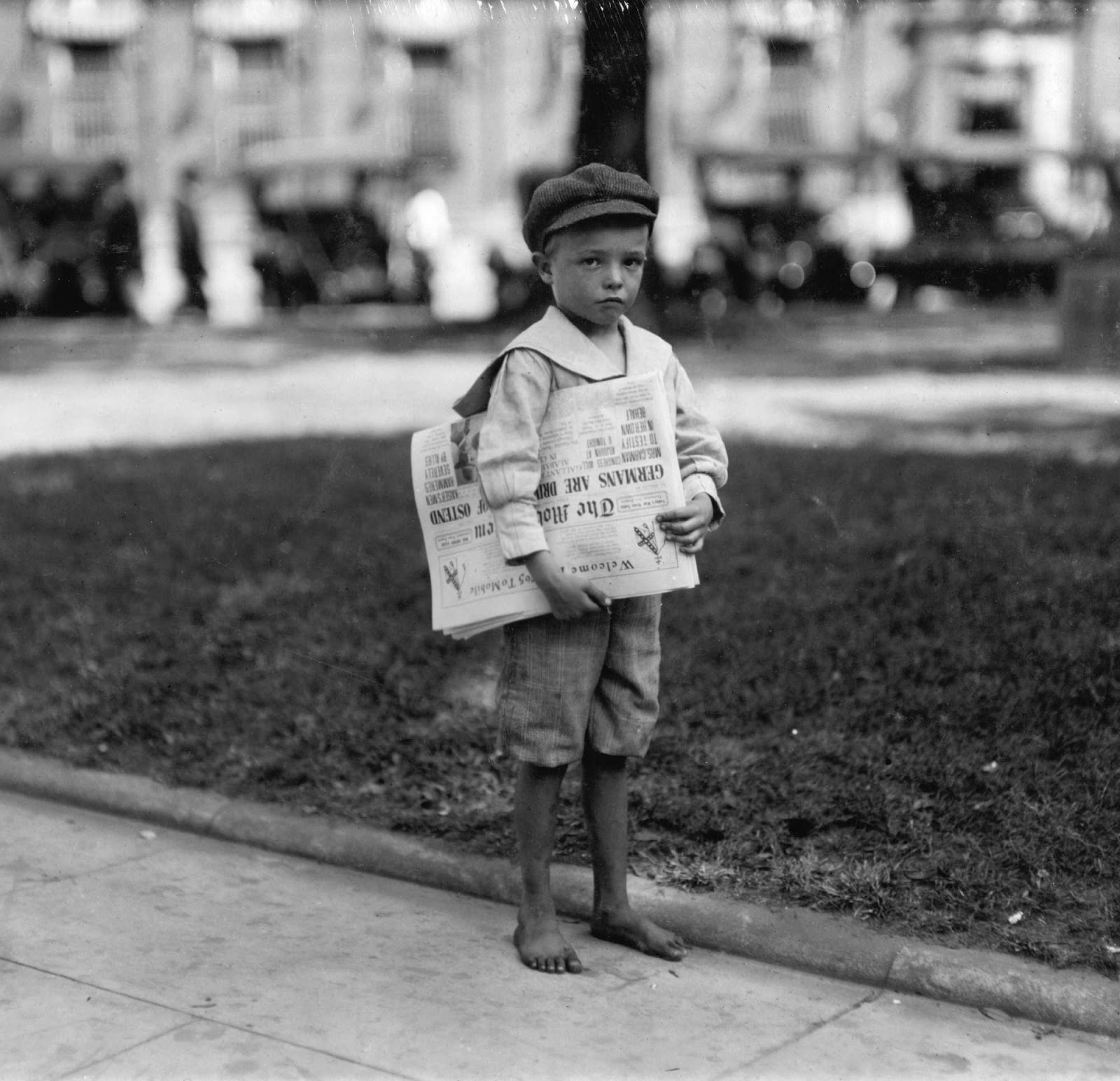 lewis-hine-7-year-old-ferris-tiny-newsie-who-did-not-know-enough-to-make-change-for-investigator-mobile-alabama-1914.jpg