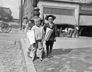 lewis-hine-richard-green-with-hat-5-year-old-newsie_-many-of-these-little-newsboys-here_-richmond-virginia-1911.jpg